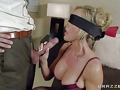 Big-chested lingerie-clad mummy Brandi Enjoy is eyes covered to make her