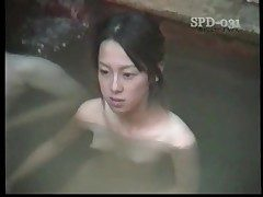 Youthful nude Asians in the public bathtub are beautiful
