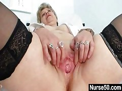 Huge-titted granny in uniform spreading her aged pussy